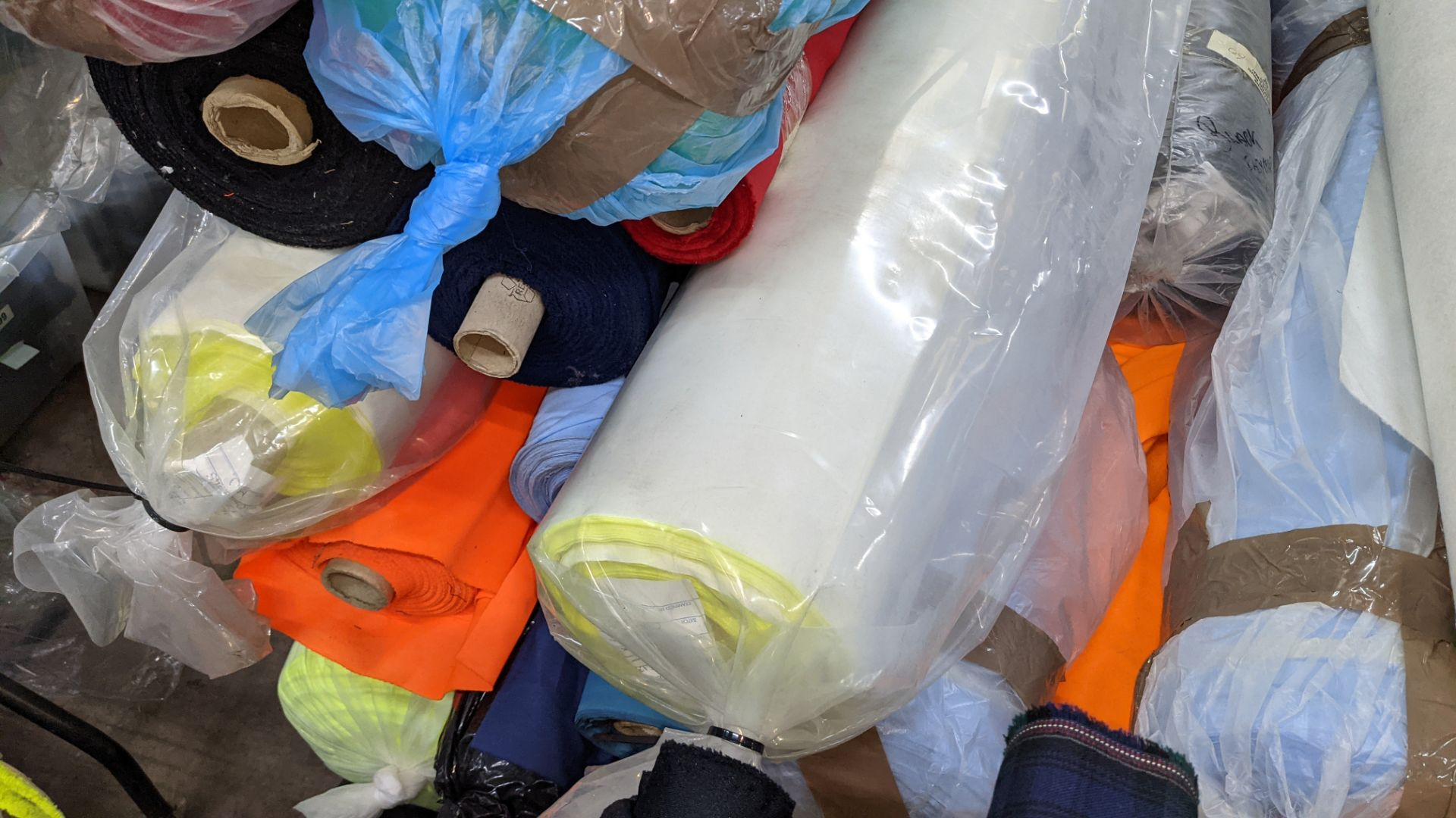 The contents of a large stillage of fabric including quantity of high visibility cloth. Please note - Image 5 of 12