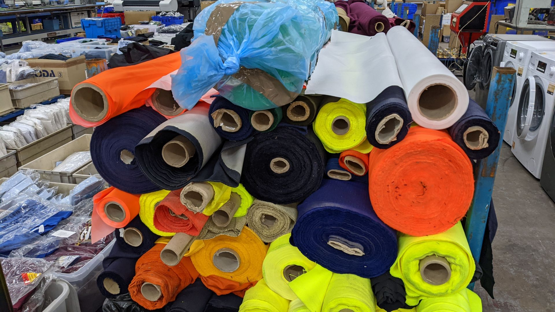 The contents of a large stillage of fabric including quantity of high visibility cloth. Please note - Image 4 of 10