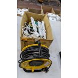 Box of electrical extension cables plus reel of extension cable as pictured in front of the box