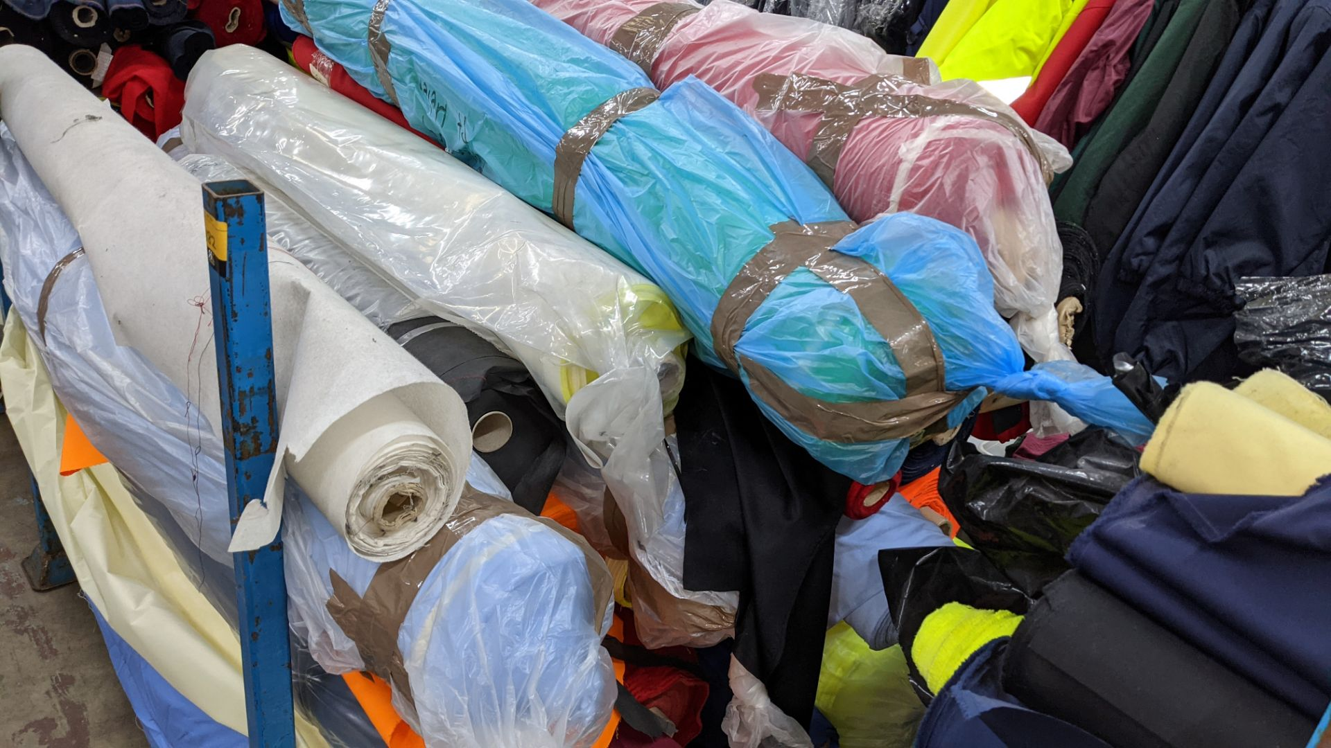 The contents of a large stillage of fabric including quantity of high visibility cloth. Please note - Image 8 of 12