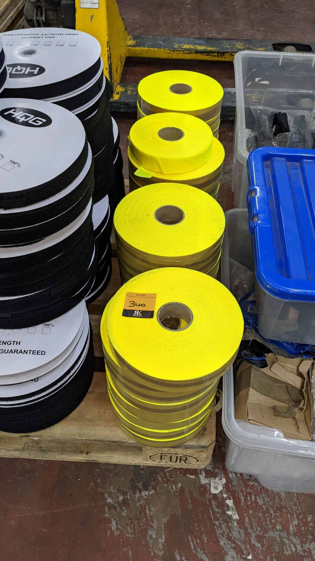 4 stacks of bright yellow tape/reflective material