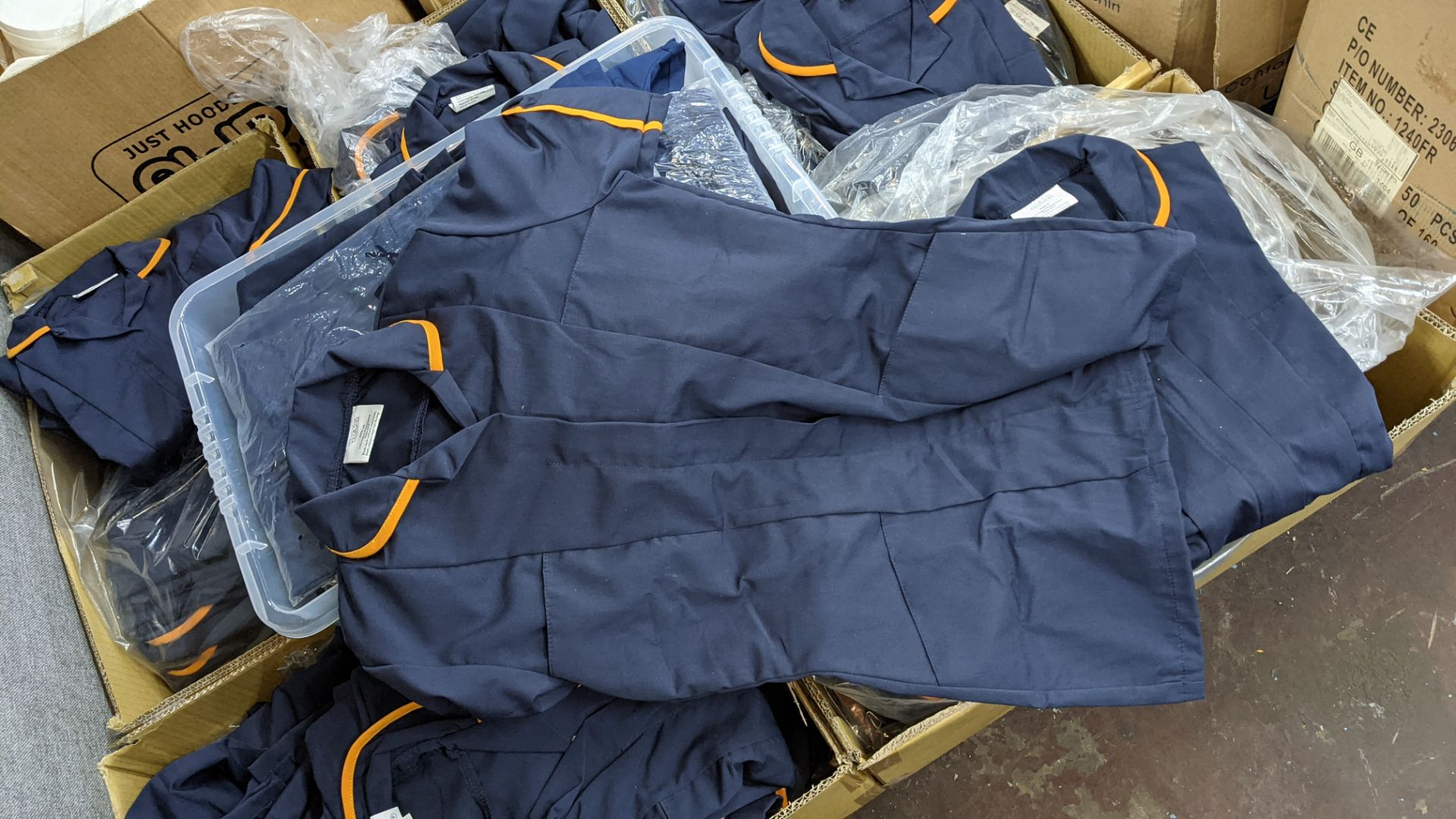 The contents of a pallet of short sleeve zip up navy tops with white or orange collars - this lot co - Image 5 of 6