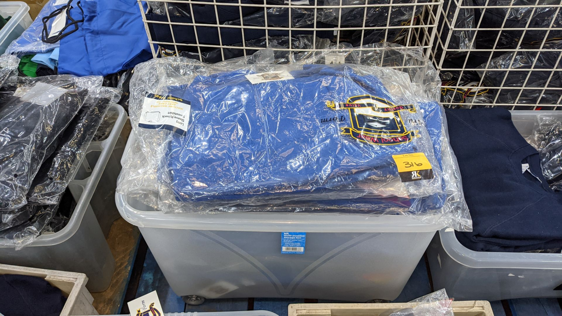 Approx 23 off blue children's sweatshirts & similar - the contents of 1 crate. NB crate excluded