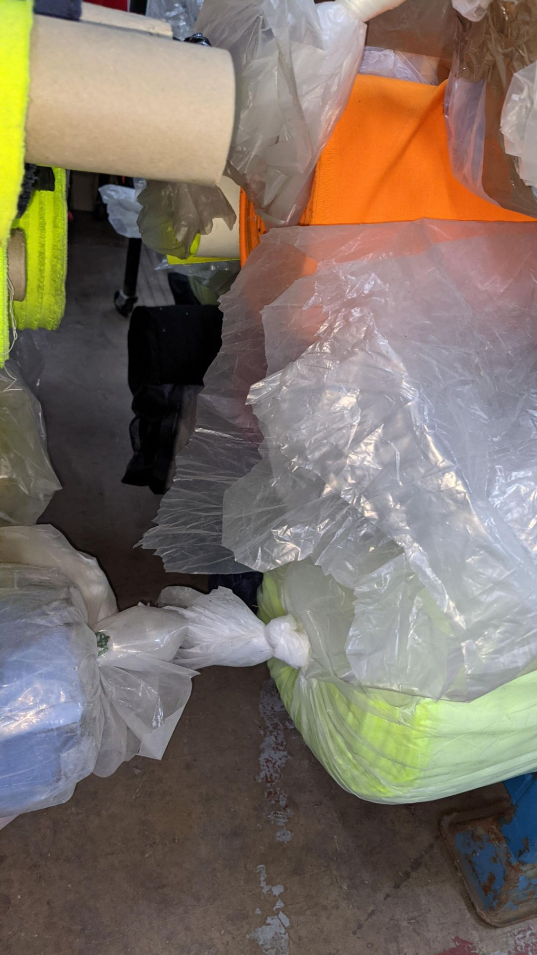 The contents of a large stillage of fabric including quantity of high visibility cloth. Please note - Image 7 of 12