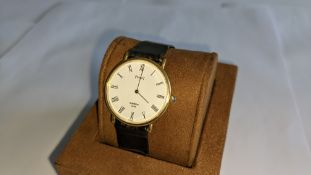 Piaget vintage yellow gold watch on leather strap. Priced (used) at £1,595. It appears to be in yell