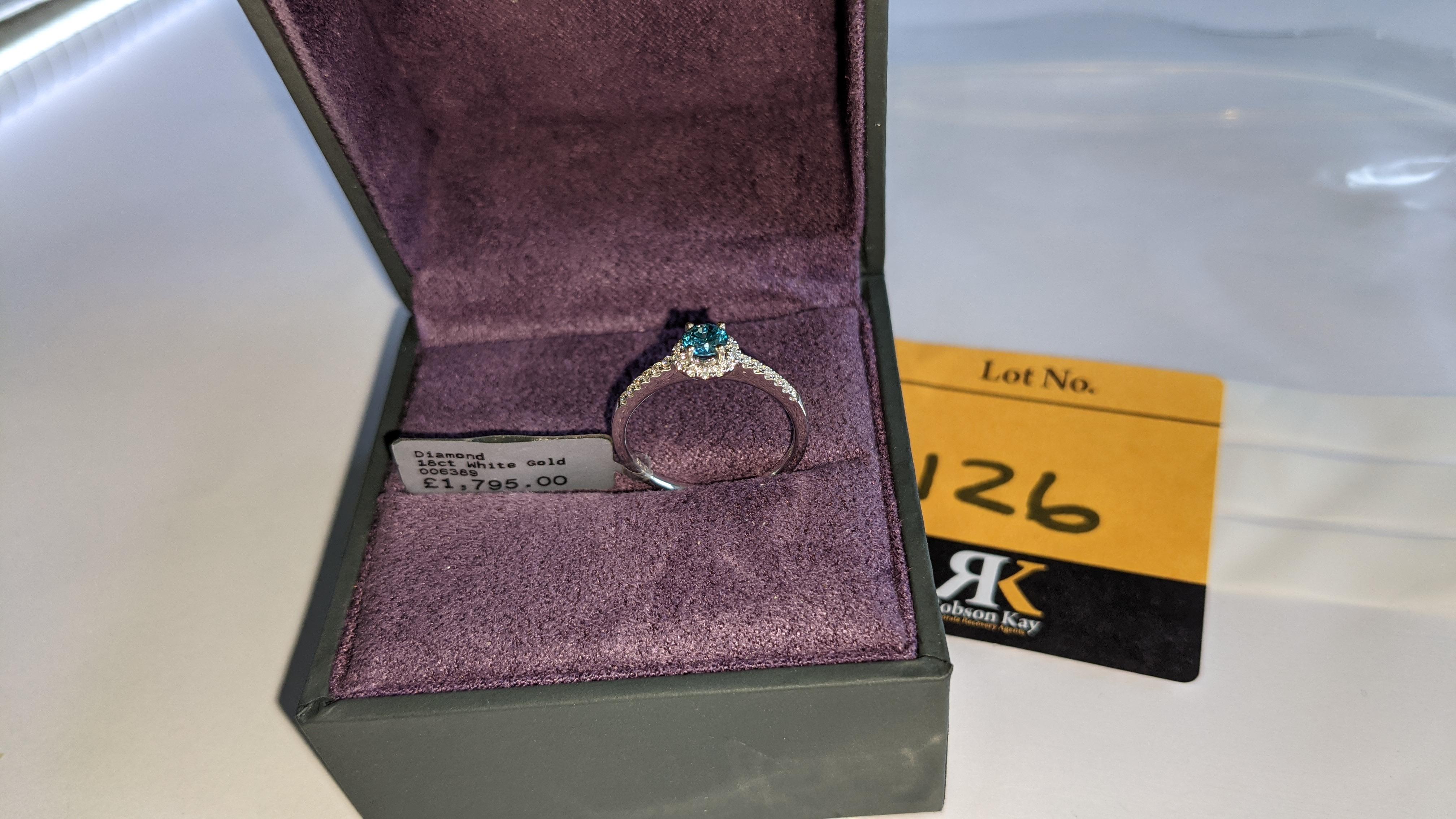 18ct white gold & diamond ring with 0.30ct blue diamond & 0.1ct of additional diamonds around the ce