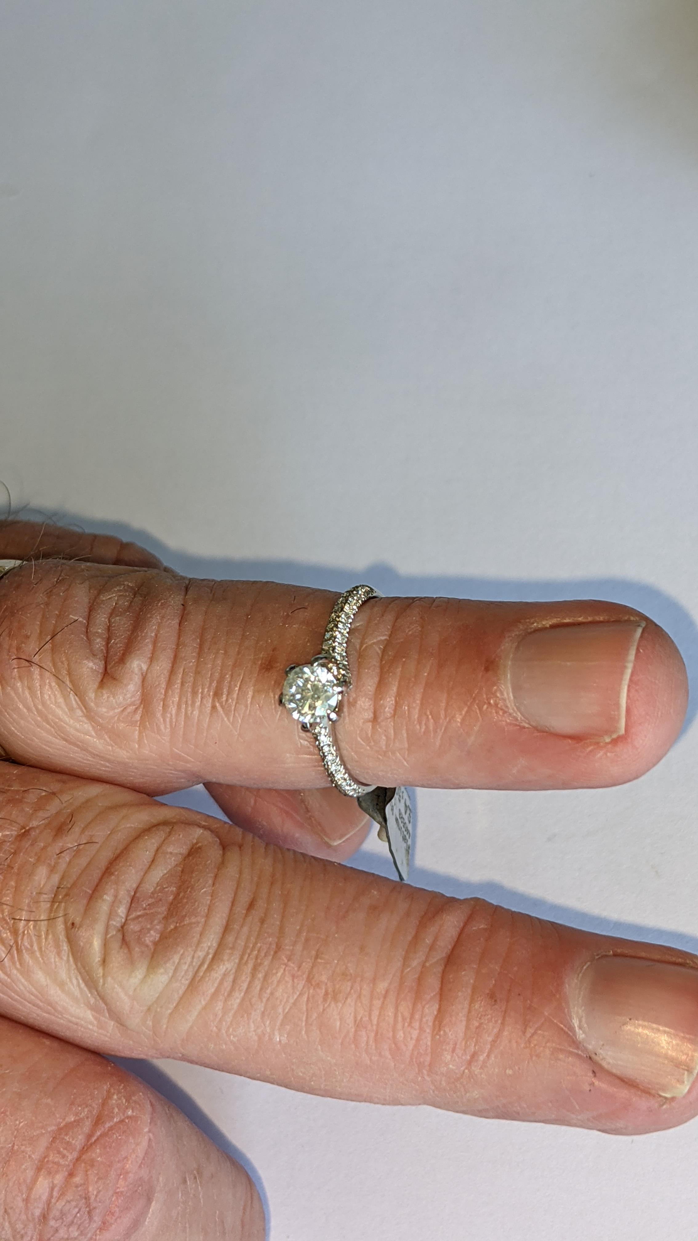 Platinum 950 diamond ring with 0.55ct central stone & 0.348ct of smaller stones on the shoulders. RR - Image 14 of 16