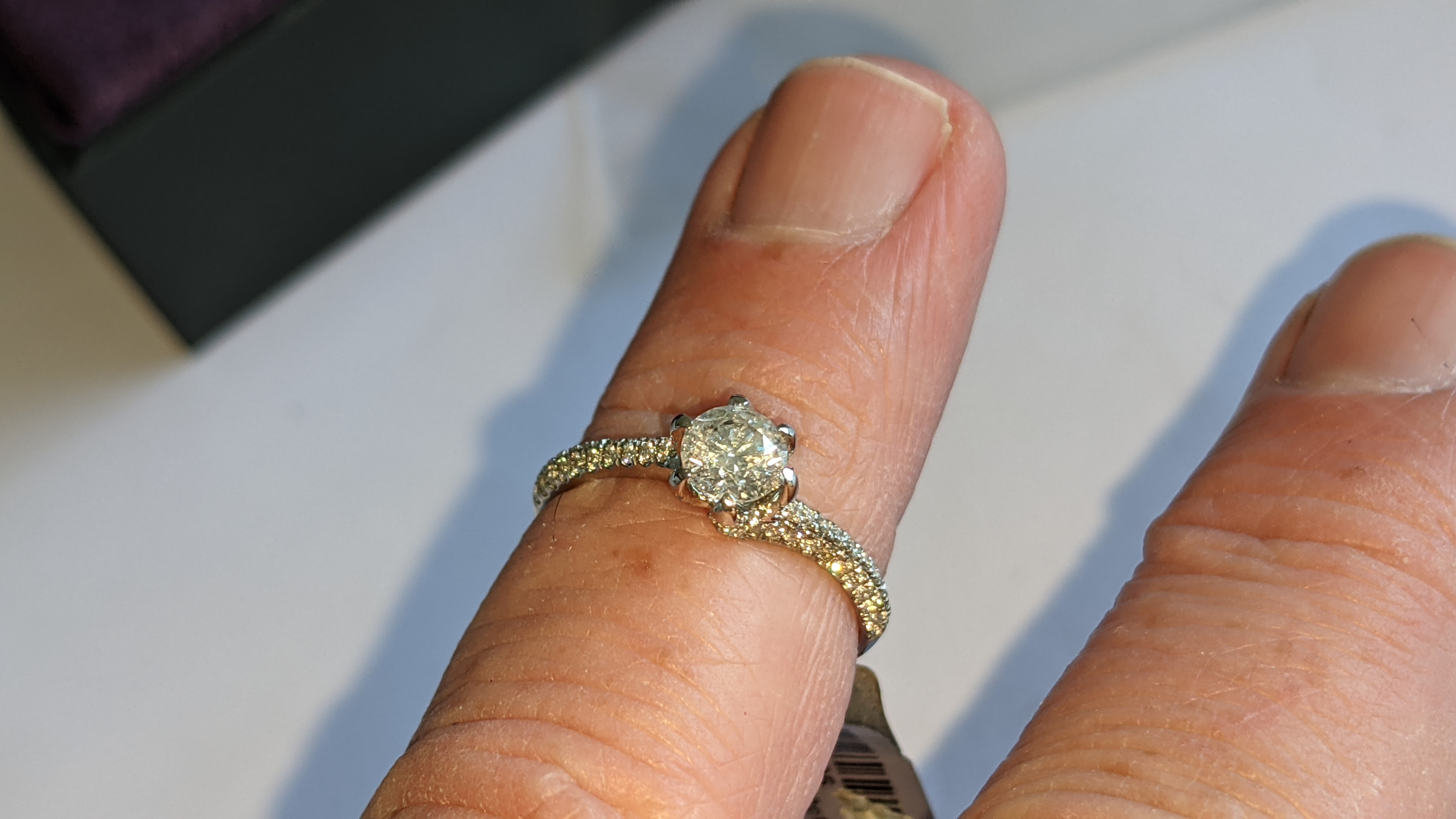 Platinum 950 diamond ring with 0.55ct central stone & 0.348ct of smaller stones on the shoulders. RR - Image 12 of 16