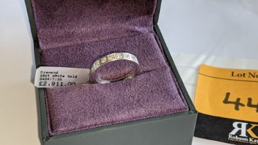 18ct white gold & diamond ring with 7 stones each weighing 0.05ct. RRP £2,911