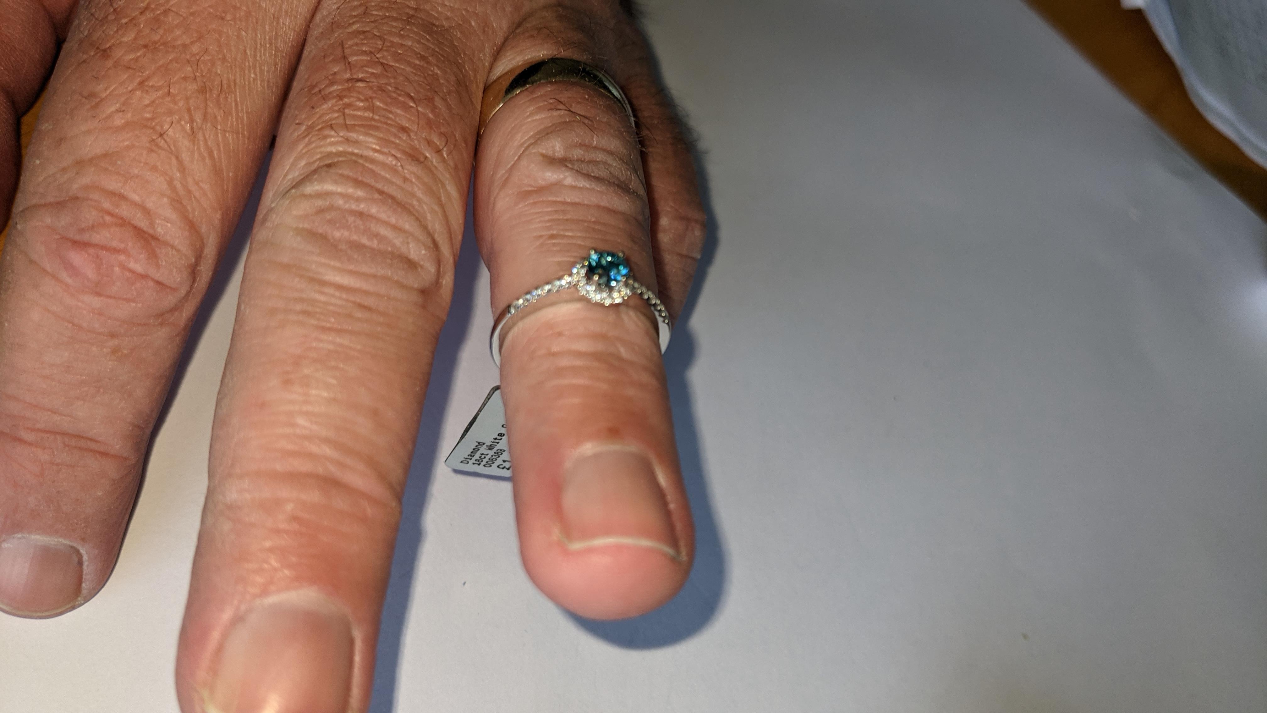 18ct white gold & diamond ring with 0.30ct blue diamond & 0.1ct of additional diamonds around the ce - Image 19 of 19