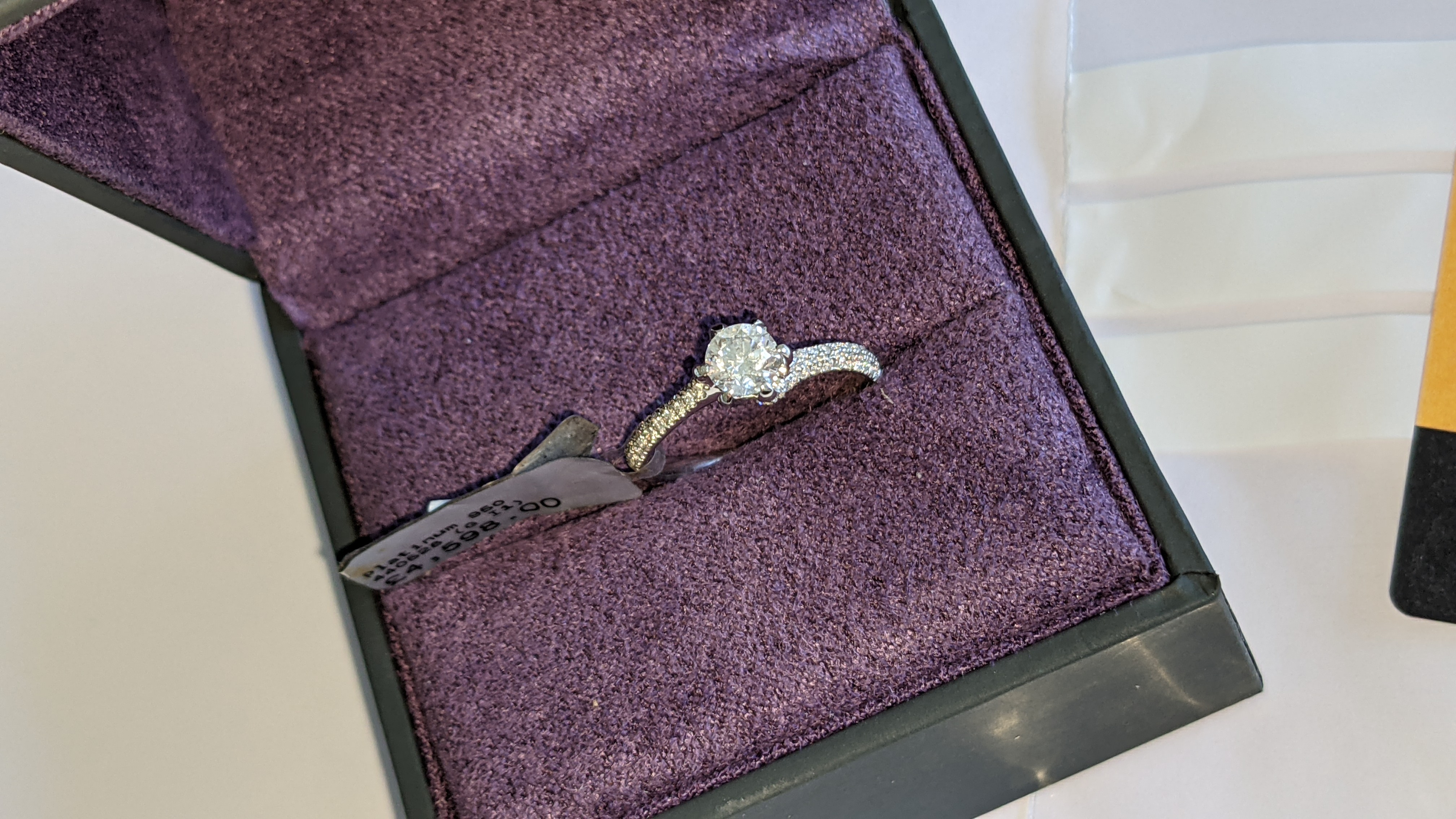 Platinum 950 diamond ring with 0.55ct central stone & 0.348ct of smaller stones on the shoulders. RR - Image 4 of 16