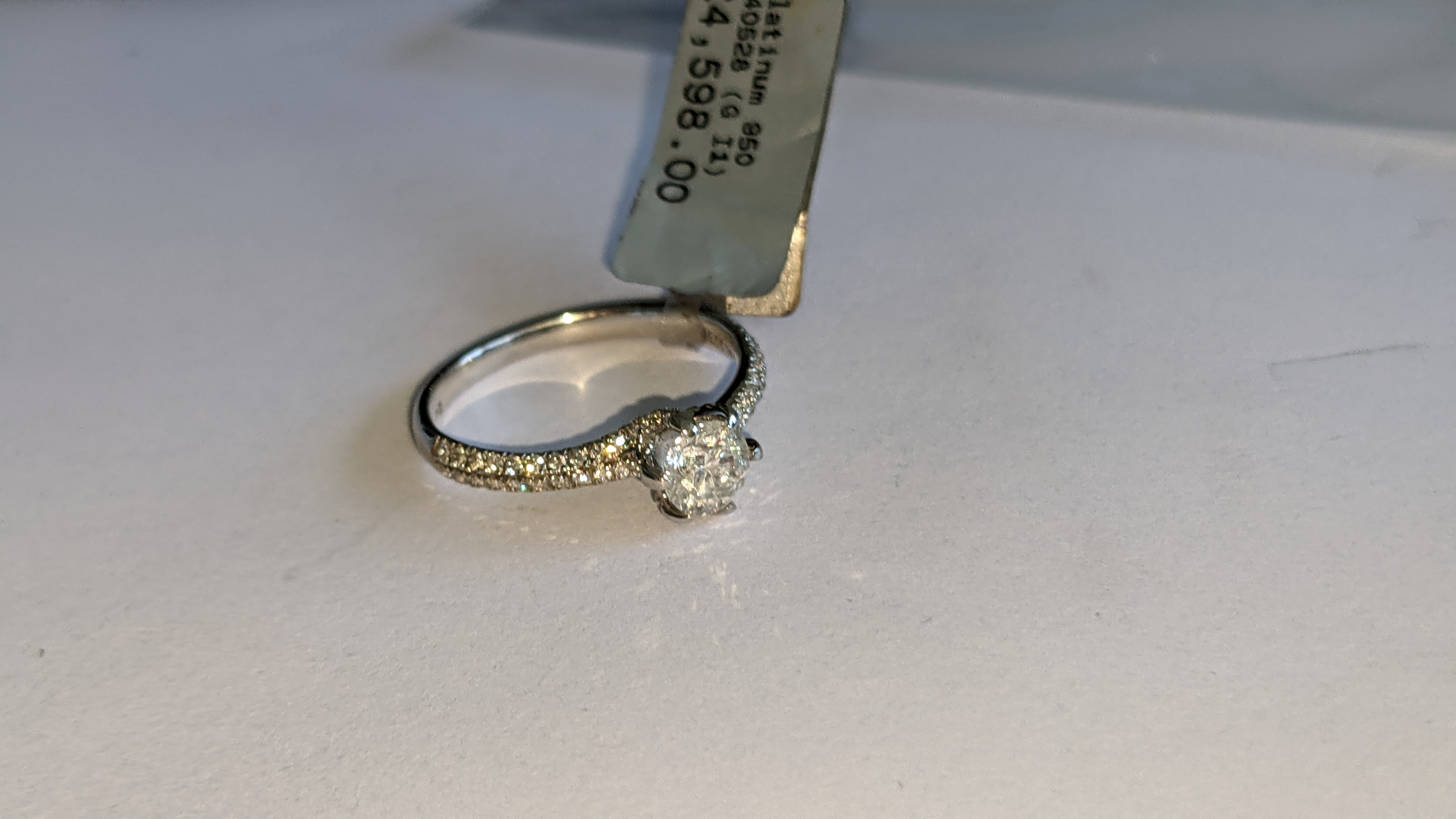 Platinum 950 diamond ring with 0.55ct central stone & 0.348ct of smaller stones on the shoulders. RR - Image 7 of 16