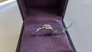 Diamond & 18ct white gold ring with centre stone flanked by 2 smaller stones all in baguette type cu