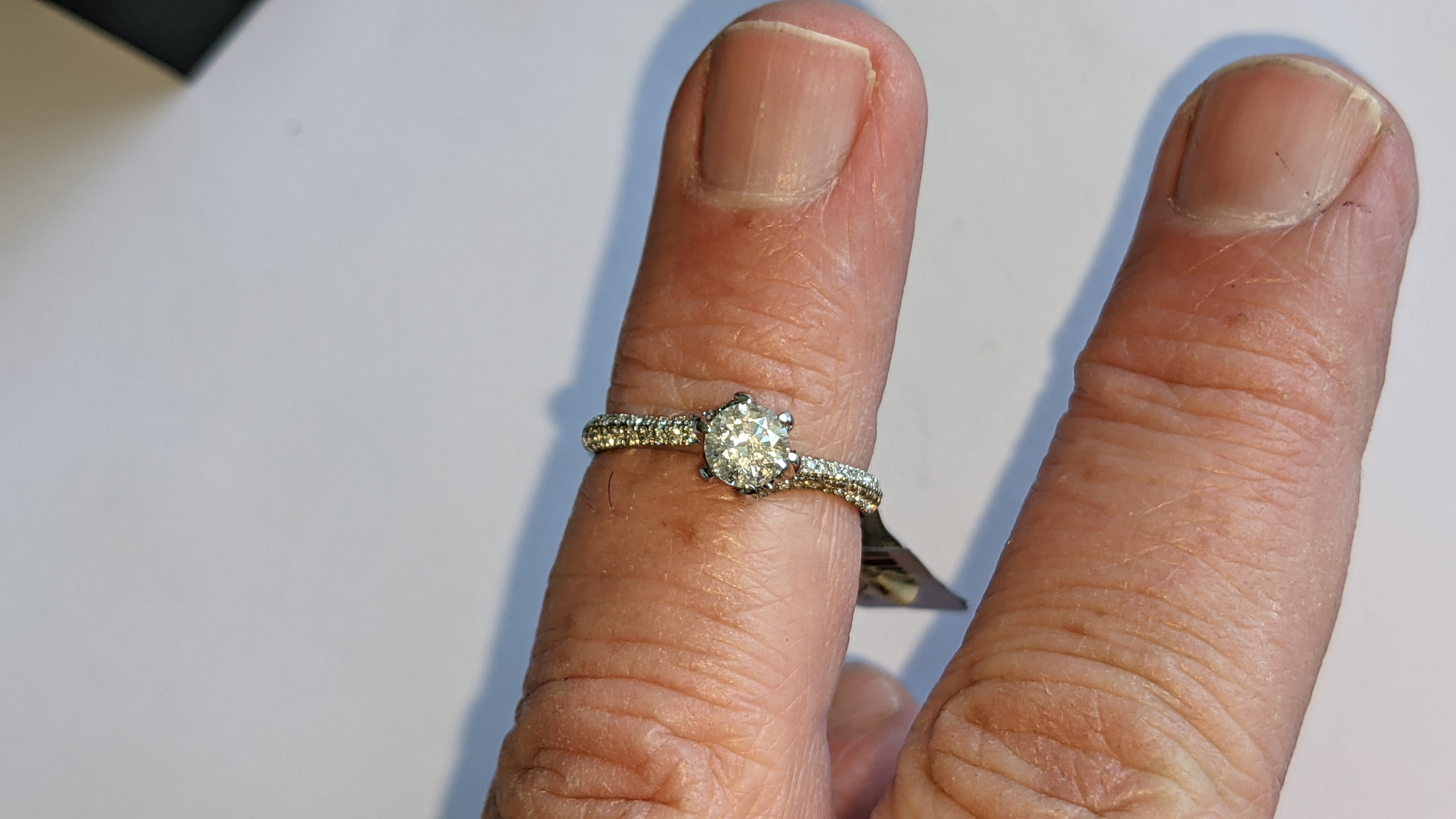 Platinum 950 diamond ring with 0.55ct central stone & 0.348ct of smaller stones on the shoulders. RR - Image 13 of 16