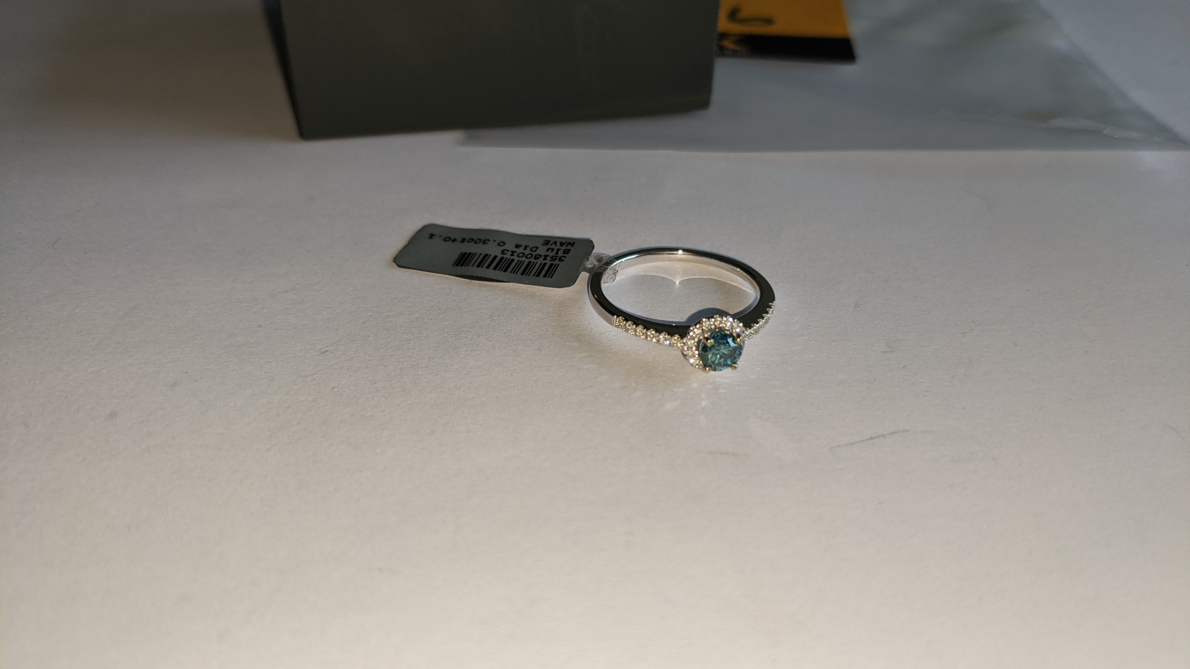 18ct white gold & diamond ring with 0.30ct blue diamond & 0.1ct of additional diamonds around the ce - Image 8 of 19