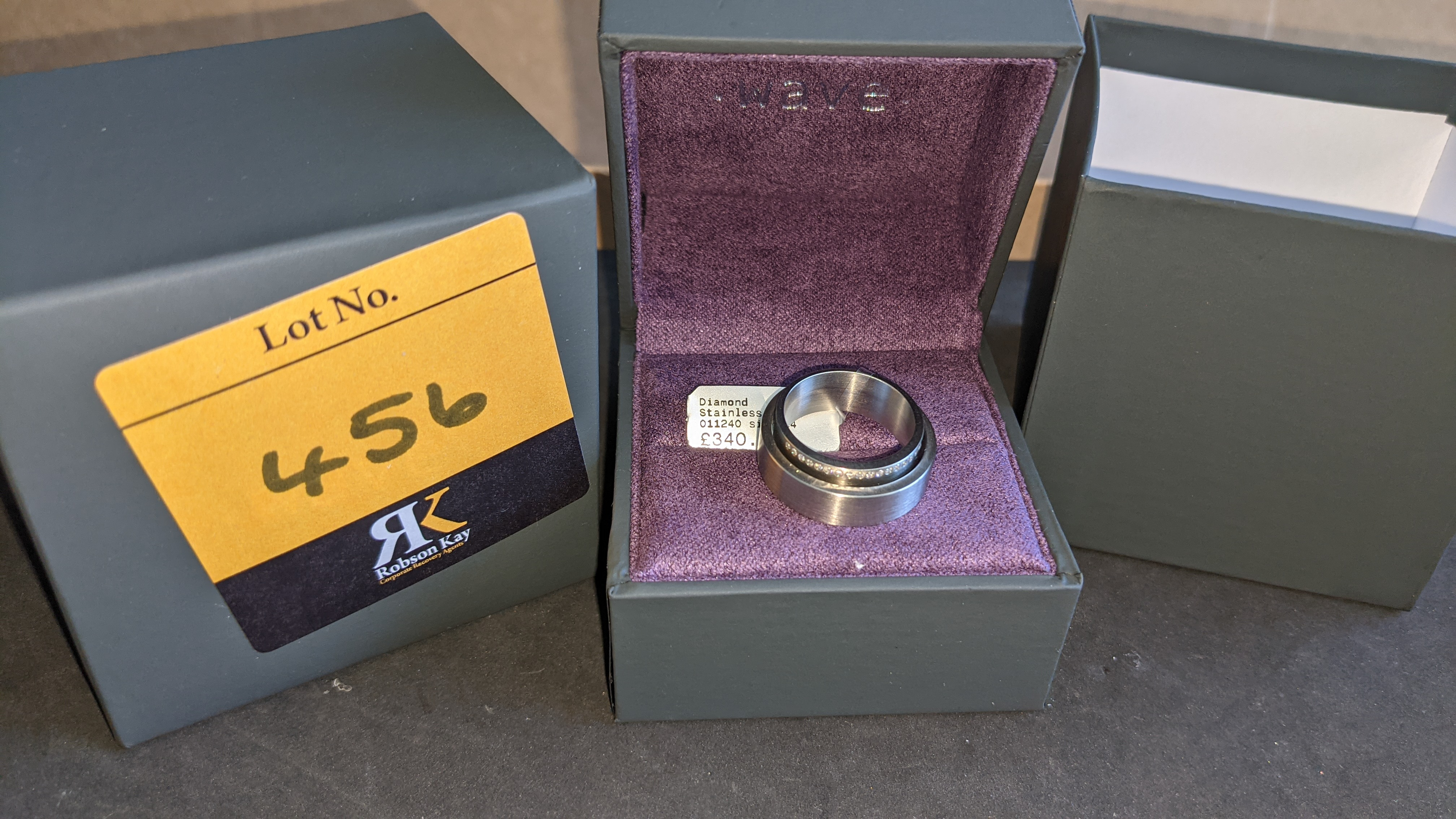Stainless steel & diamond unusually shaped ring with inner & outer circles joined on one side, RRP £