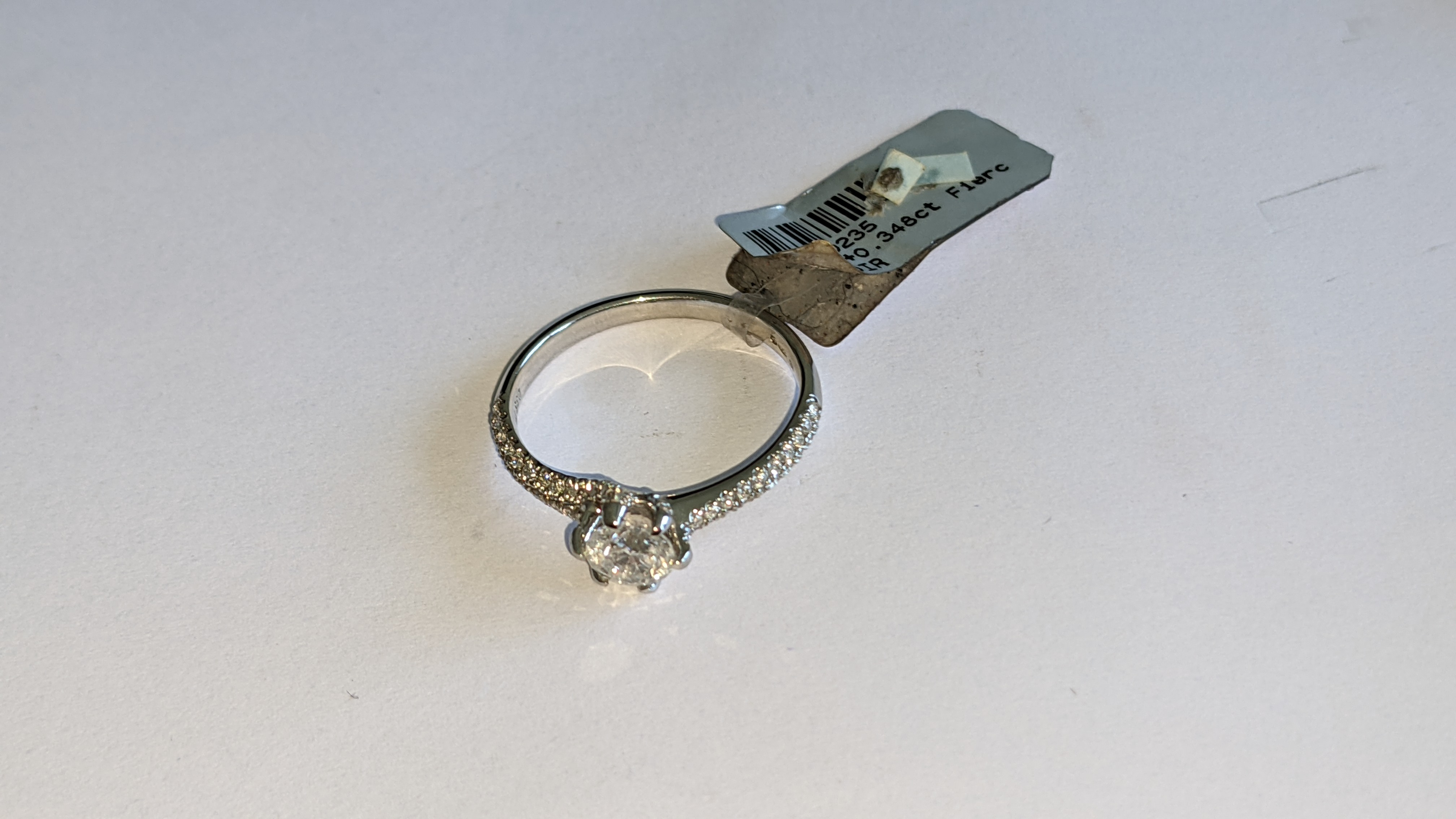 Platinum 950 diamond ring with 0.55ct central stone & 0.348ct of smaller stones on the shoulders. RR - Image 8 of 16