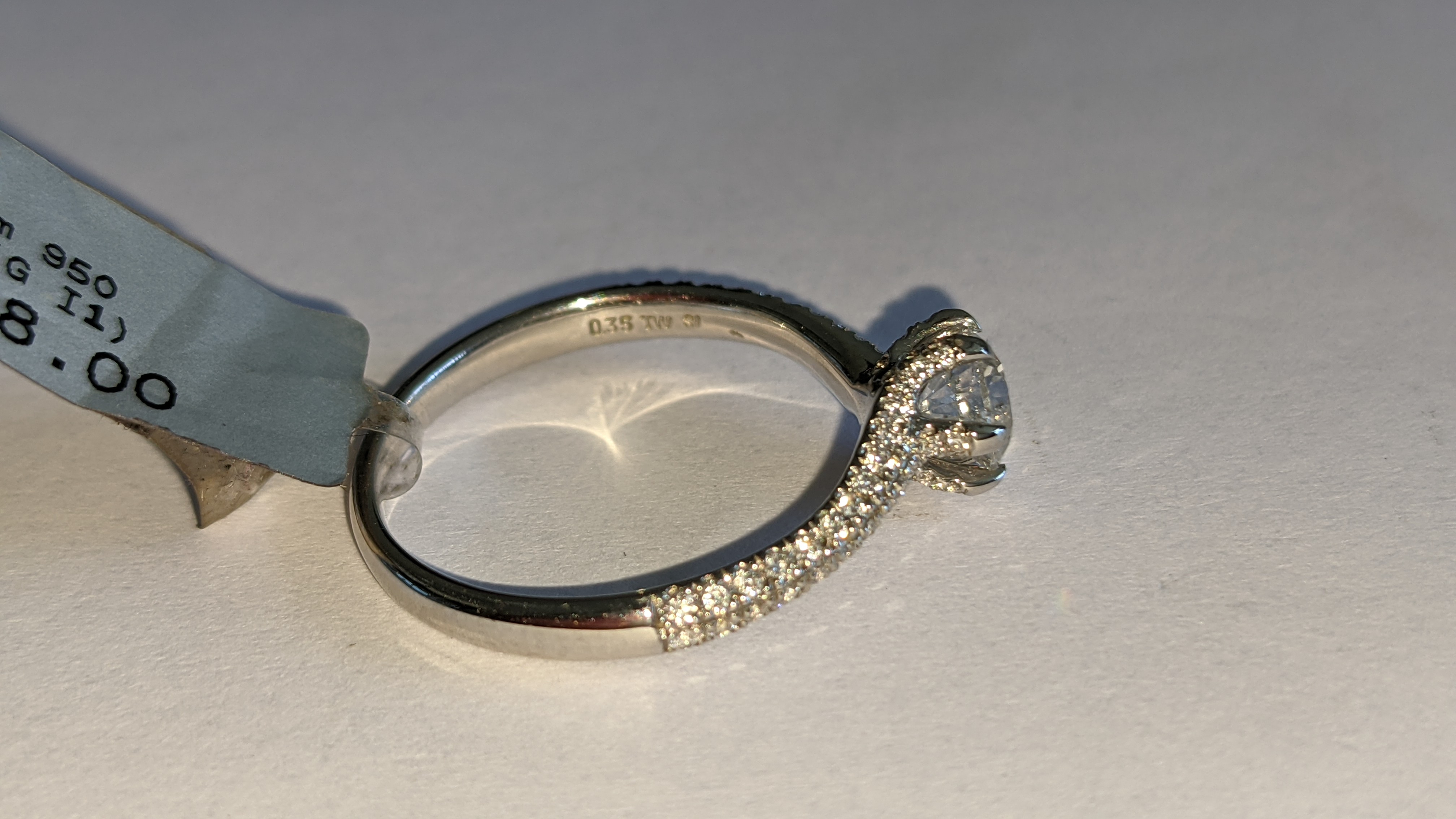 Platinum 950 diamond ring with 0.55ct central stone & 0.348ct of smaller stones on the shoulders. RR - Image 10 of 16