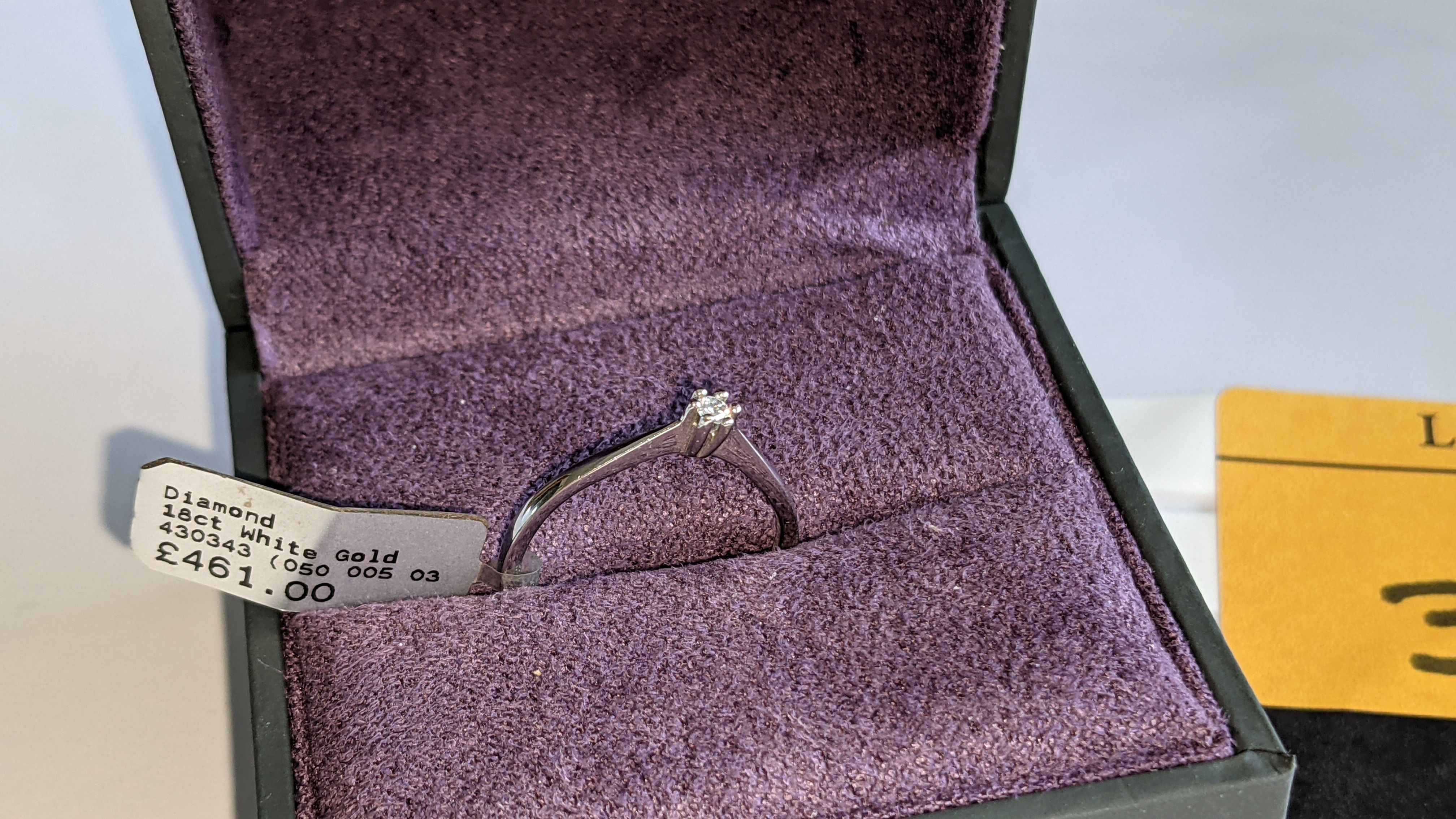 18ct white gold ring with central 0.05ct diamond. RRP £461