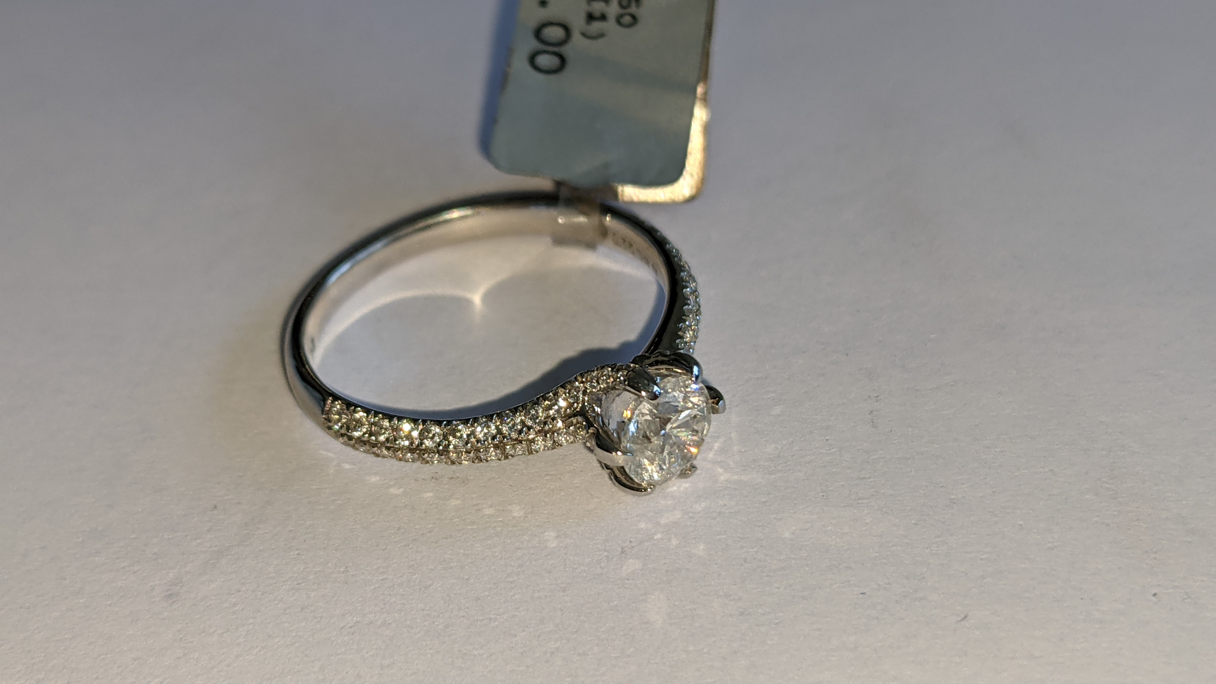 Platinum 950 diamond ring with 0.55ct central stone & 0.348ct of smaller stones on the shoulders. RR - Image 6 of 16