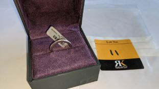 Platinum 950 ring with diamonds set into channels on 3 sides. RRP £1,729