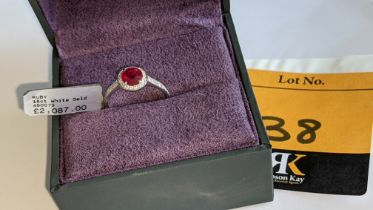 18ct white gold ring with central ruby & 0.27ct diamonds around the ruby & on each shoulder. RRP £2