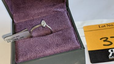 Platinum 950 ring with marquise shaped central diamond plus diamonds on the shoulders either side, t