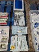 Row of metal implements & trays as pictured