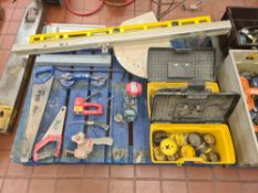 Contents of a pallet of miscellaneous items including hand tools, boring heads, handling equipment,