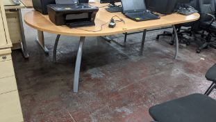 Oval meeting table on silver grey metal legs, max. dimensions of tabletop circa 2400mm x 1200mm
