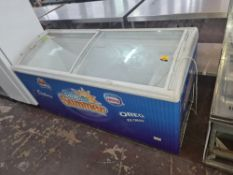 Clear topped chest freezer measuring approx. 1750mm x 650mm x 870mm