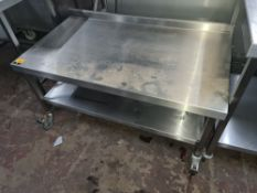 Stainless steel twin-tier table with splashback measuring 1200mm x 670mm x 600mm