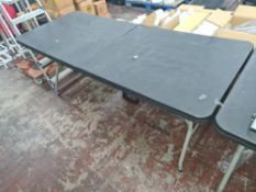 4 off heavy-duty folding trestle tables with plastic tops & metal legs, incorporating a carry handle