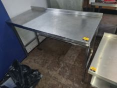 Stainless steel tall table with splashback measuring approx. 1300mm x 595mm