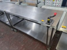 Heavy duty mobile twin-tier table with max. dimensions approx. 1500mm x 700mm x 820mm. This lot incl
