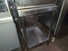 Stainless steel twin-tier table with splashback measuring 550mm x 750mm x 870mm. NB. The appliance s