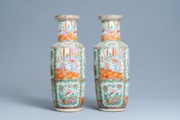 A pair of Chinese Canton famille rose rouleau vases, 19th C.