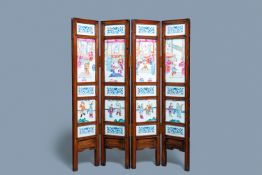 A Chinese wooden four-fold screen with famillle rose plaques, 19th C.