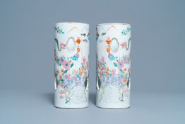 A pair of reticulated Chinese famille rose '100 boys' hat stands, Qianlong mark, 19th C.