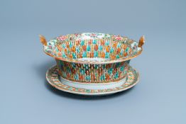 A reticulated Chinese Canton famille rose basket on stand, 19th C.