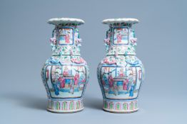 A pair of Chinese famille rose 'court scene' vases, 19th C.
