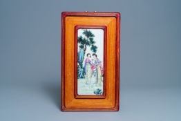 A Chinese famille rose plaque with two ladies in a garden, Republic