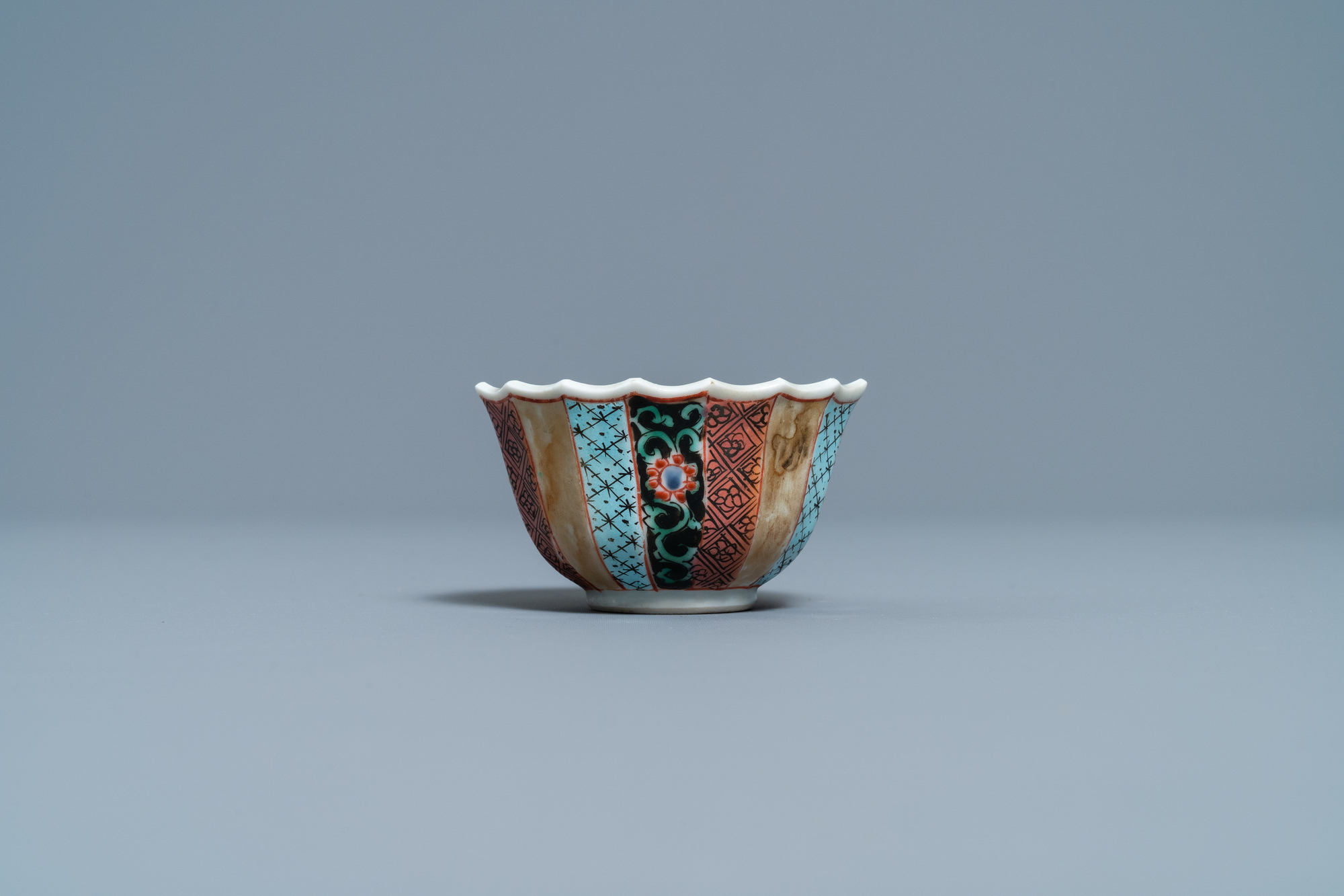 A lobed Chinese famille rose 'fishermen' cup and saucer, Yongzheng - Image 7 of 9