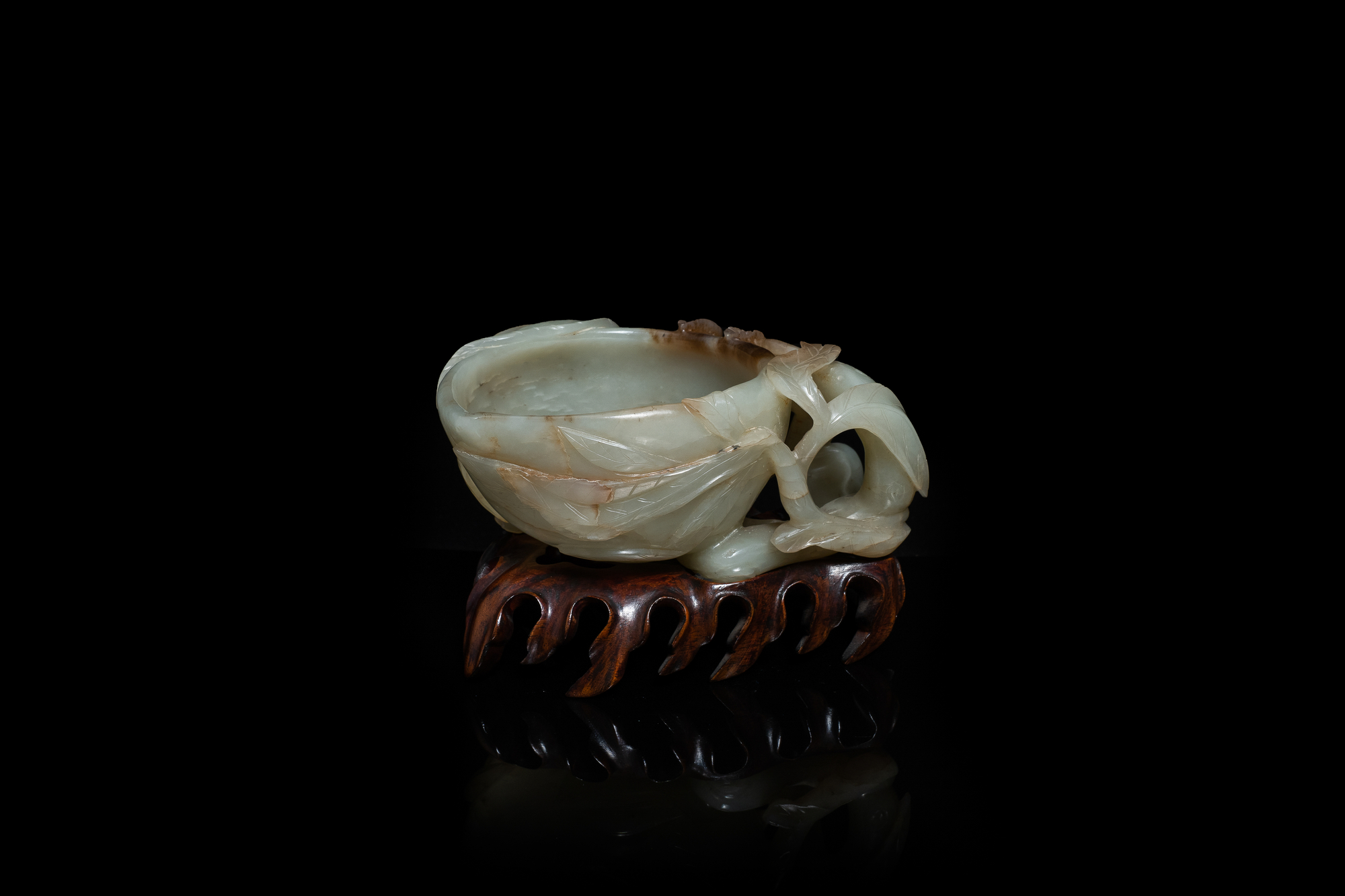 A Chinese mottled celadon and brown jade peach-form brush washer, Qing