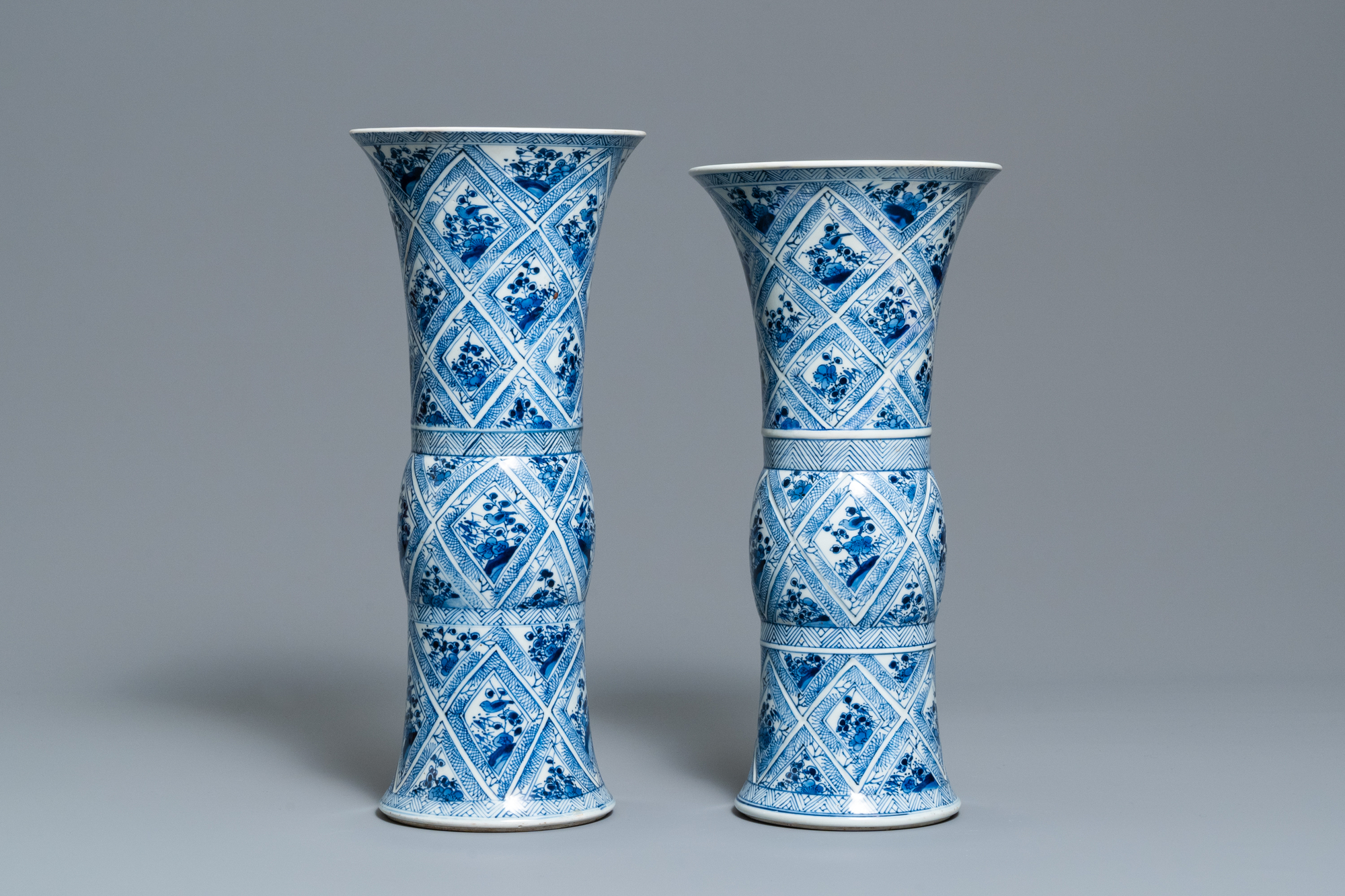 A large Chinese blue and white five-piece garniture with floral and landscape panels, Kangxi - Image 10 of 66