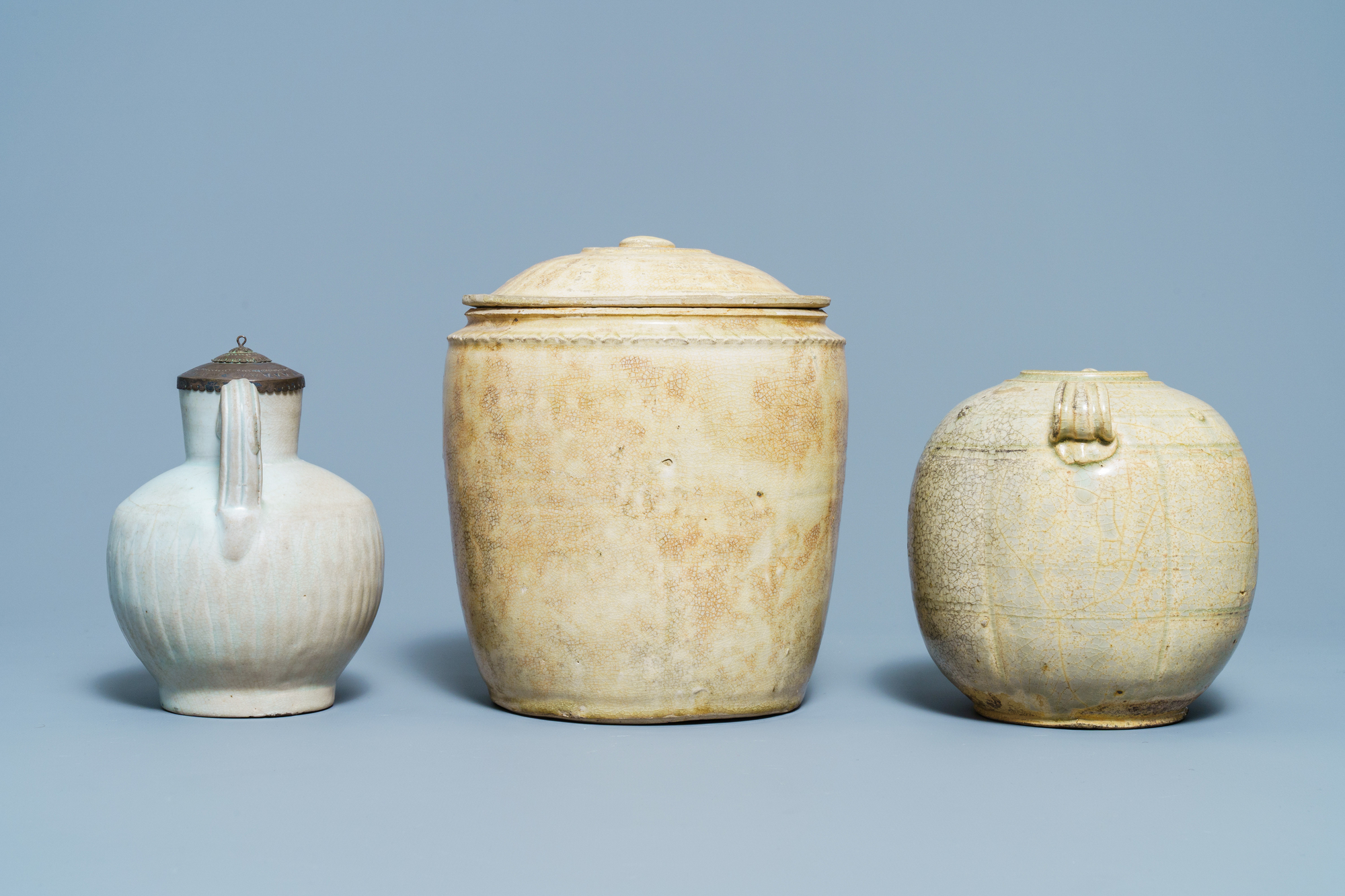 A Chinese celadon-glazed 'Jue' ewer, a qingbai-glazed wine ewer and a storage vessel, Song/Yuan - Image 3 of 9