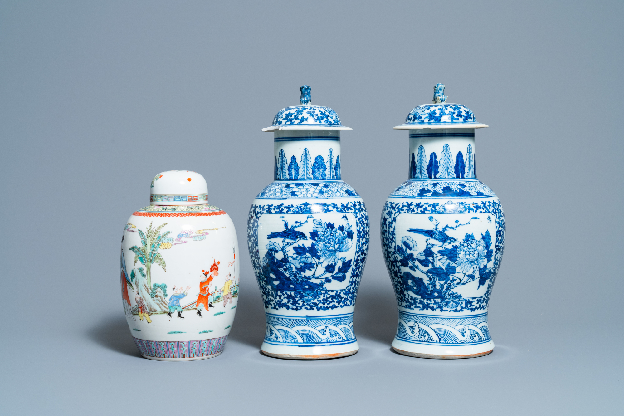 A pair of Chinese blue and white vases and a famille rose jar and cover, 19/20th C. - Image 4 of 9