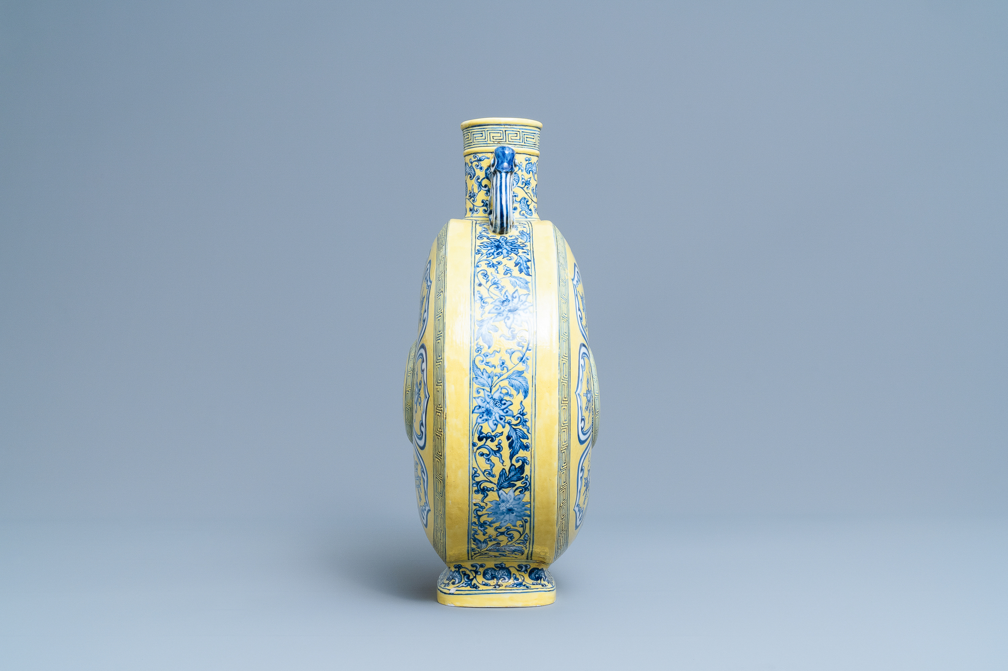 A Chinese yellow-ground blue and white 'Bajixiang' moonflask vase, Yongzheng mark, 19/20th C. - Image 4 of 20