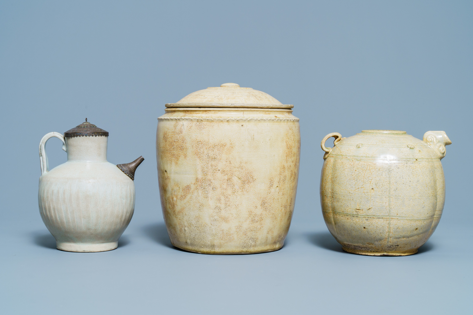 A Chinese celadon-glazed 'Jue' ewer, a qingbai-glazed wine ewer and a storage vessel, Song/Yuan - Image 4 of 9