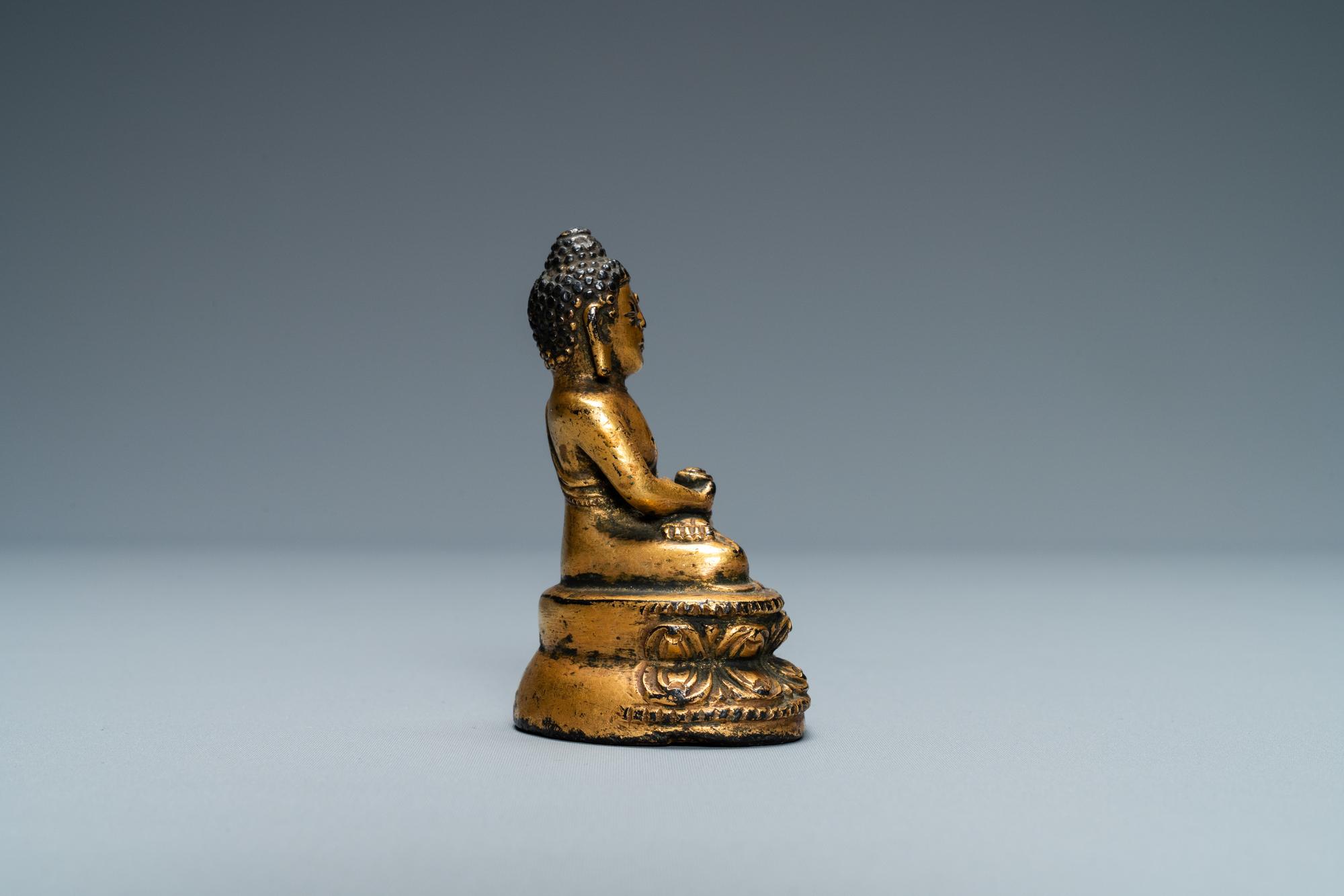 A Sino-Tibetan gilt bronze figure of Buddha, Ming - Image 4 of 7